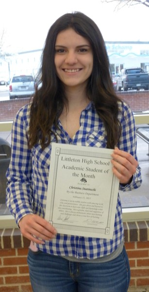 Cristina with an award at the end of her academic year.