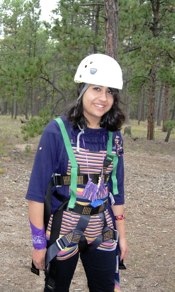 Sara getting ready to take on the high ropes challenge course at her student arrival orientation.