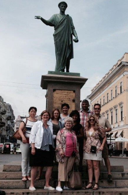 Janice along with her family, Masha and her family, and Calyn and her family pose for a photo while in Odessa, Ukraine.