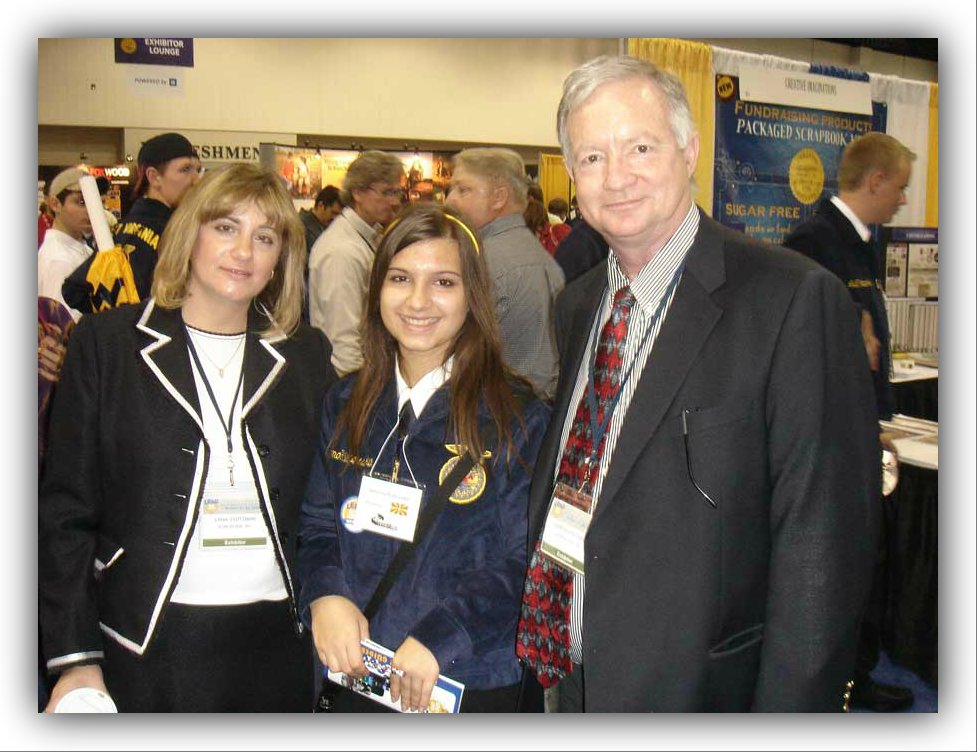 Curtis Stutzman; World Link President, and Lana Stutzman; National Program Coordinator, with a student at the 2009 National FFA Convention.