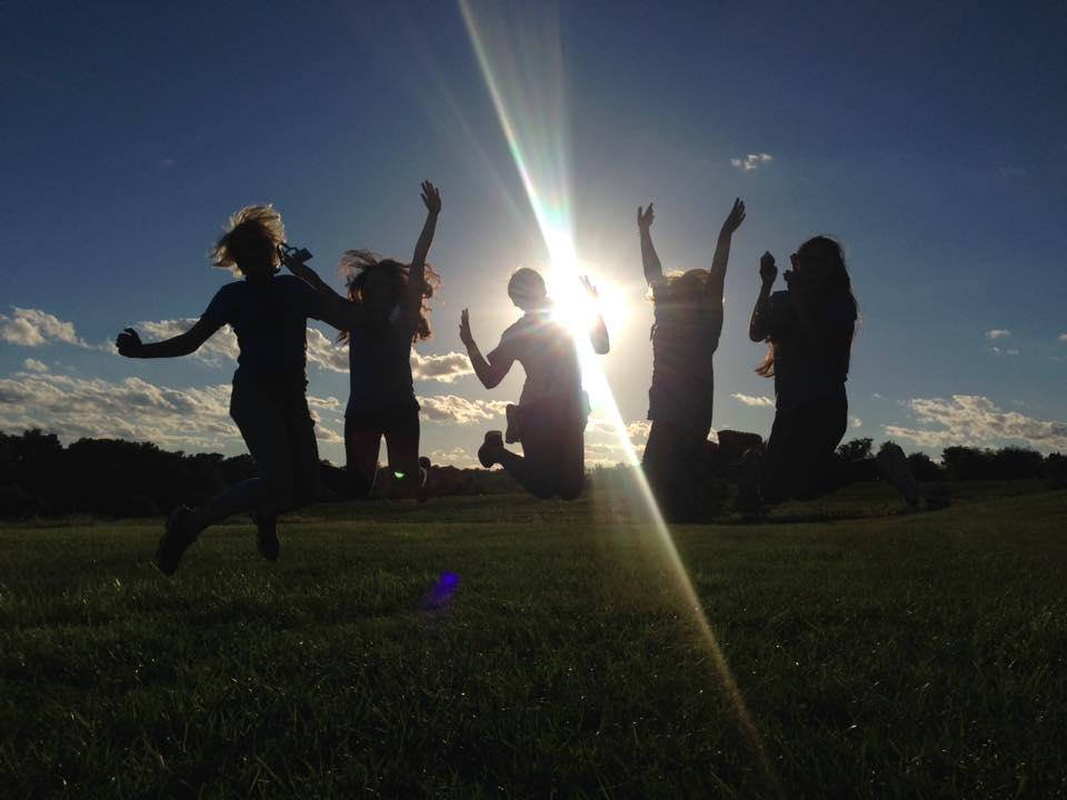 group-jumping-sun