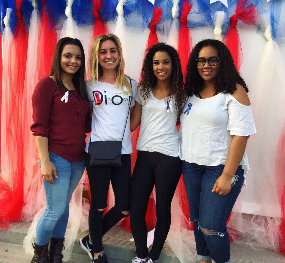 """Marina (2nd from the left), along with her team of peers who helped fond the """"Women Against Domestic Violence"""" club in Hanford West High School."""