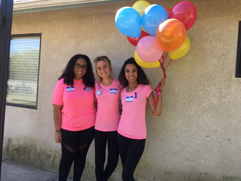 Marina (center) with two of her club team members.