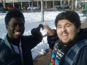 Serigne and Murad (exchange brothers) making a heart at Midterm.