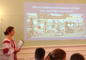 Iryna presenting on the billboard issue.