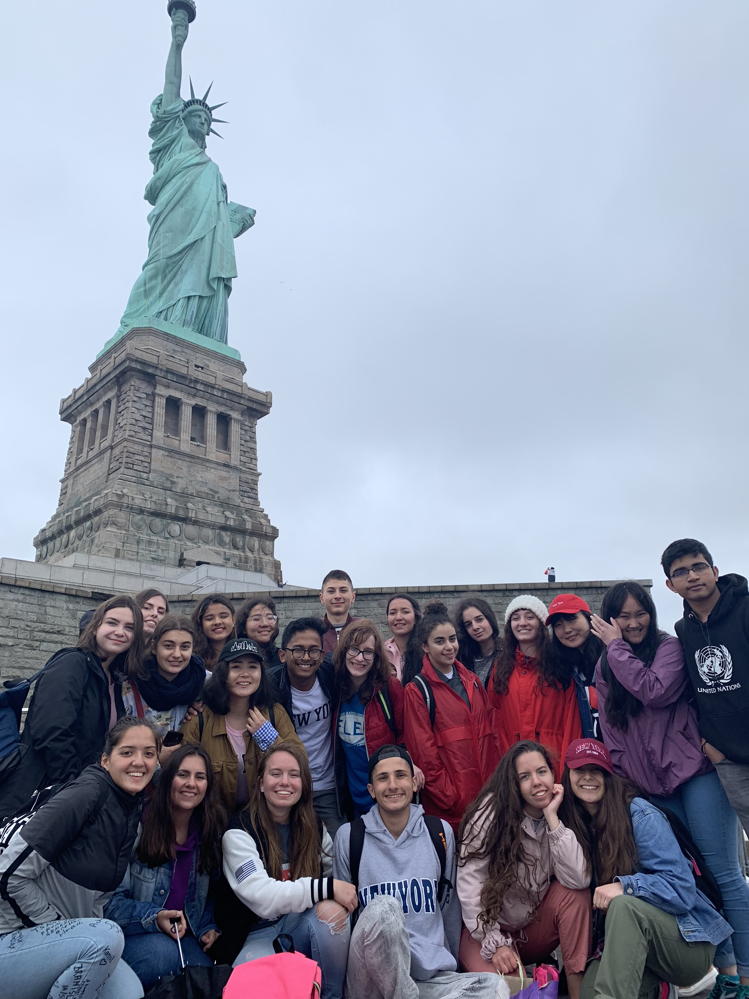 Vira (center) with other World Link PAL-NYC participants, visiting the Statue of Liberty in New York City.