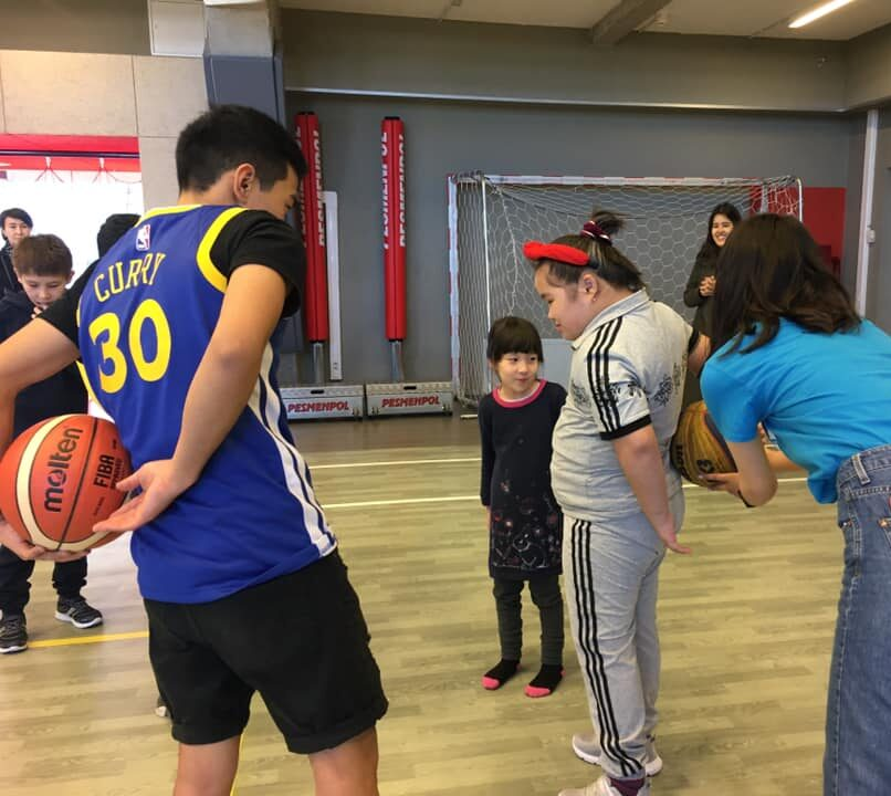 Volunteers working with children with specials needs during one Basketball for All clinic.