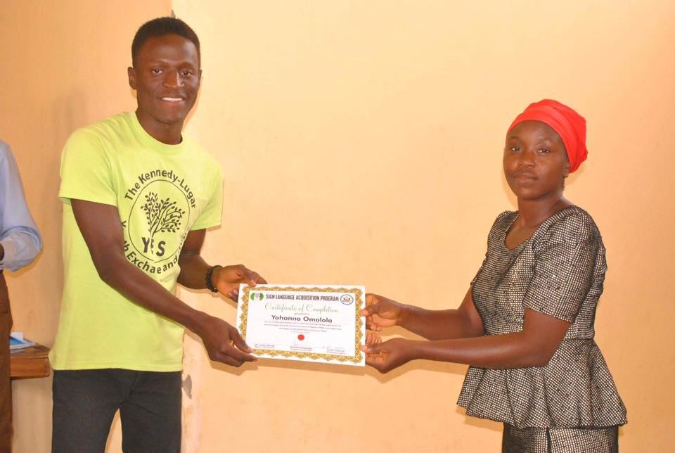 Nehemiah Danjuma with sign language participant