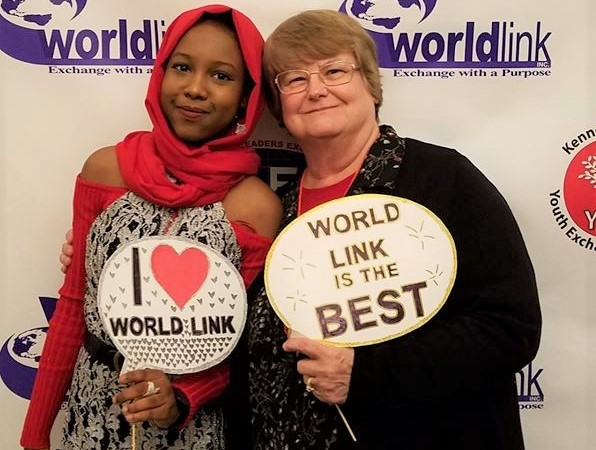 Local Volunteer Diana and a World Link Student during a conference.