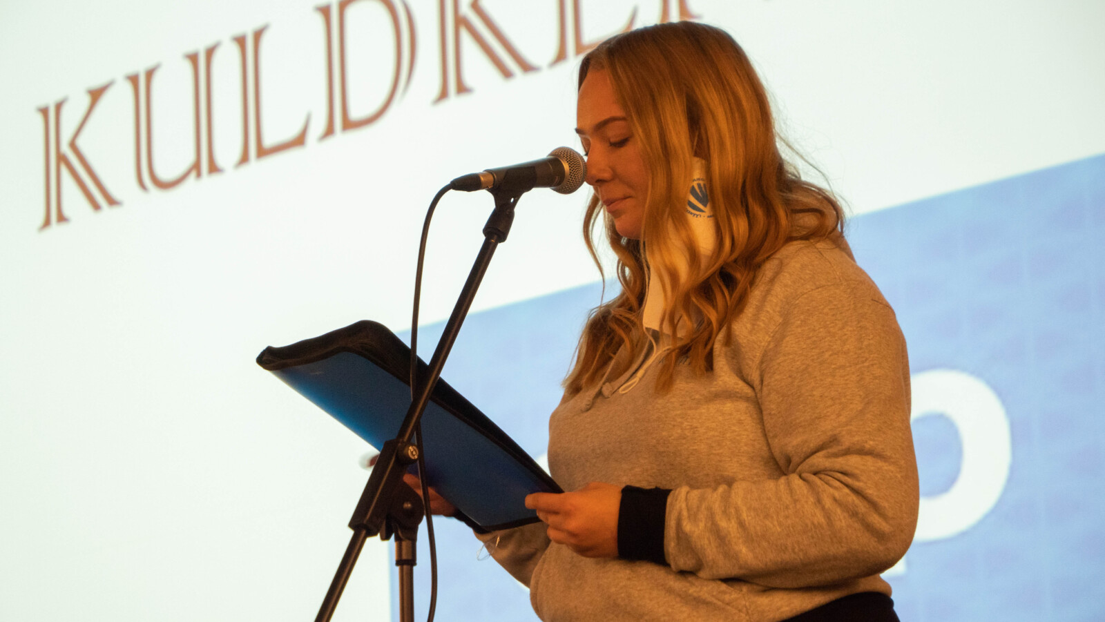 Karmen giving a speech at a youth conference.