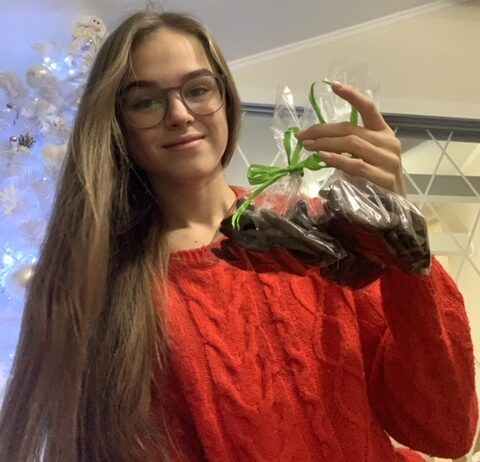 Anastasiia holding her chocolate cookies before sharing them with the homeless.