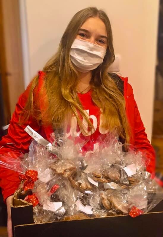 Maria holding her kindness cookies before donating them to families in need.