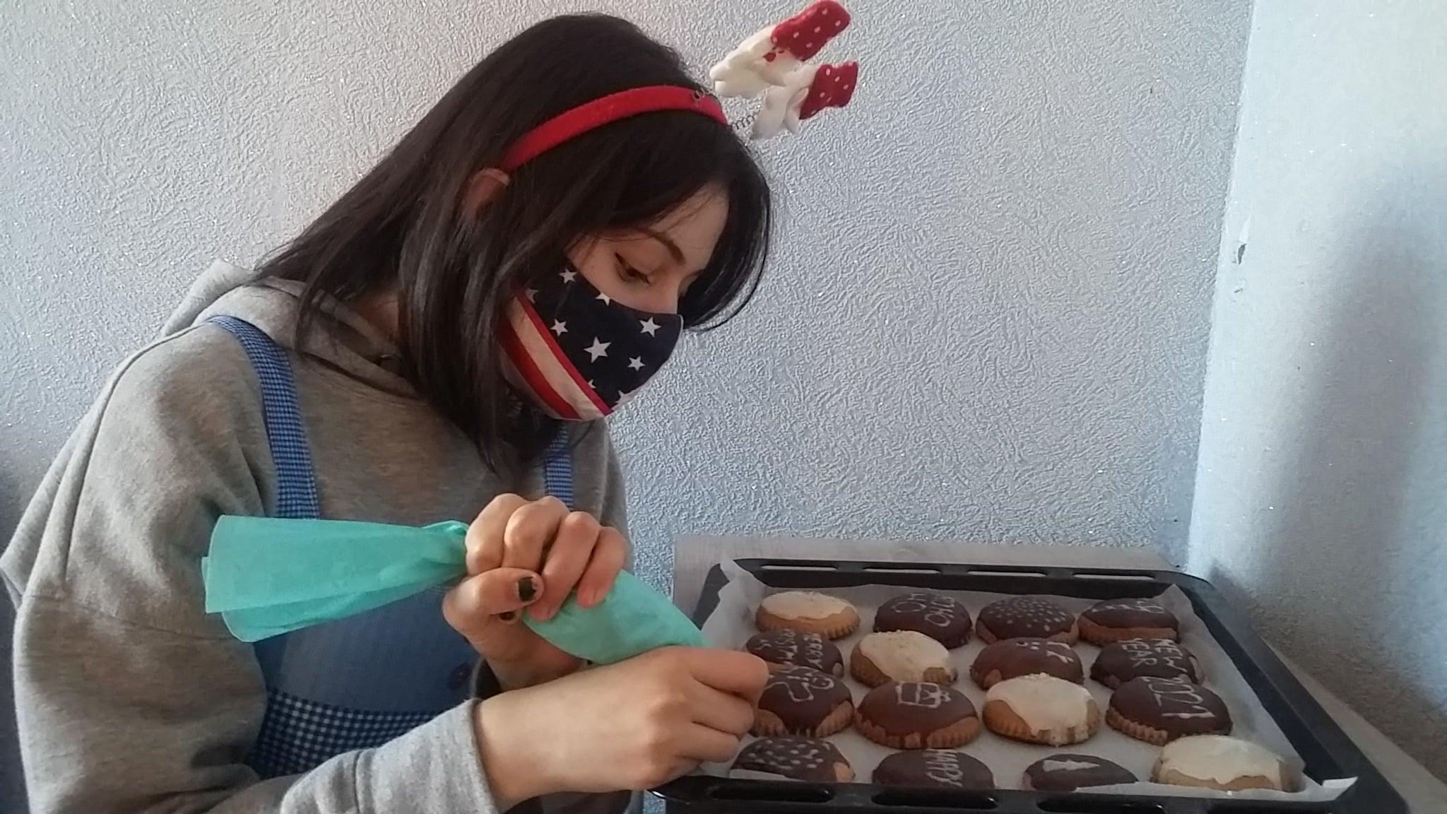 Nino B decorating her Kindness Cookies.